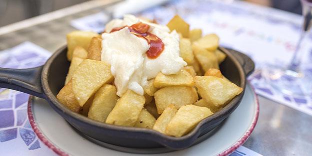 Cuál es el origen de las patatas bravas